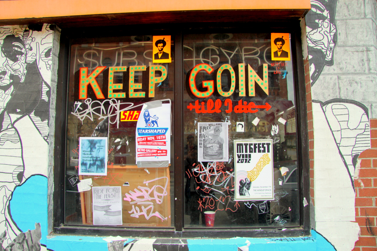 The outside of the N.Y. Fried building is a riot of graffiti, street art, fliers and notices. (Photo by Fern Shen)