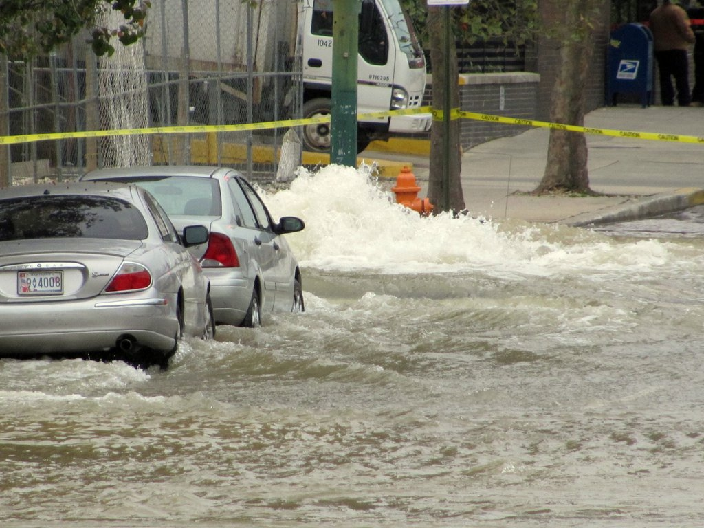 Water rockets out of the 60-inch broken water line at Charles and 20th streets this morning. (Photo by Mark Reutter)