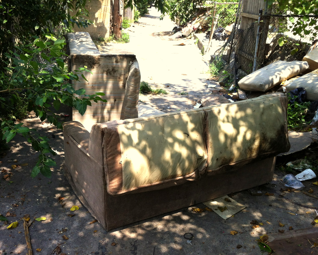 Trash and furniture put in the alley behind Annapolis Road to block the police. (Photo by Linda Towe)