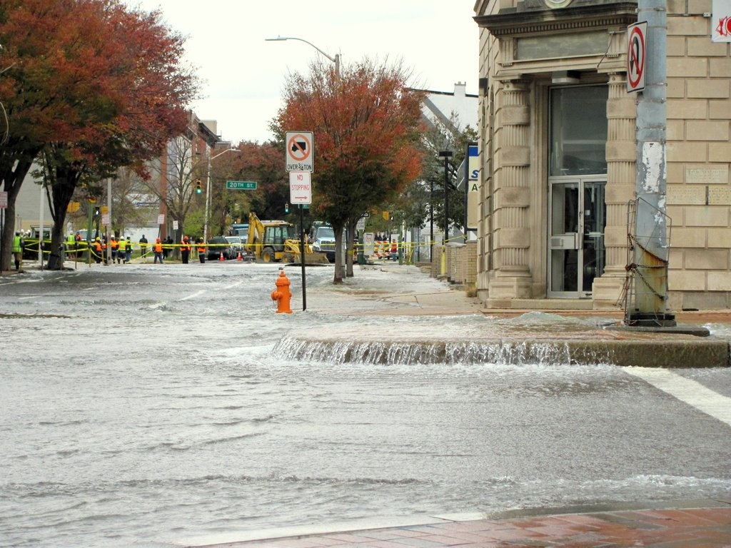 Waterfall on North Avenue: a new addition to the Charles North streetscape. The water main break can be seen in background. (Photo by Mark Reutter)