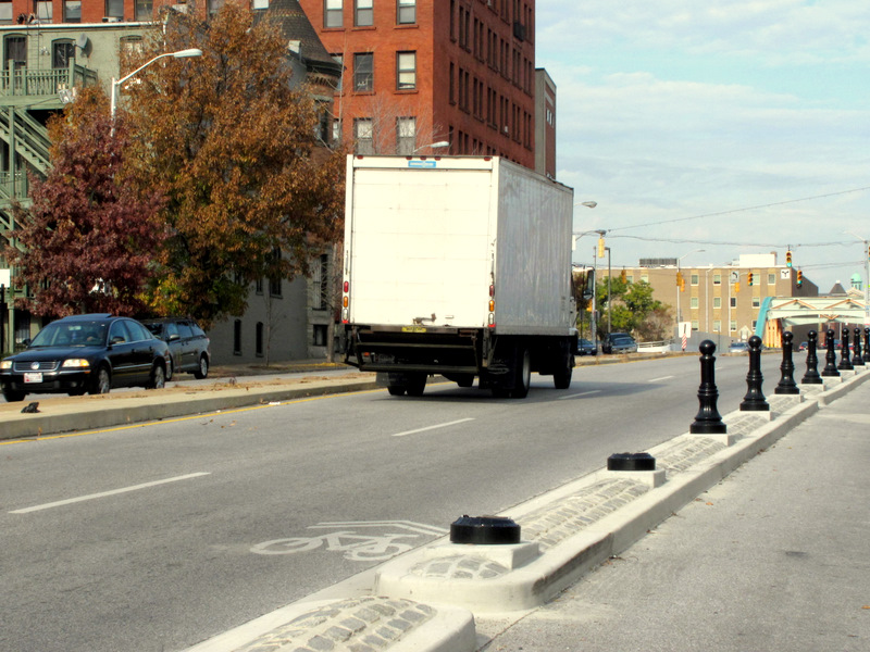 Two bollards recently went missing near the intersection where traffic on Biddle Street turns north onto Guilford. (Photo by Mark Reutter)