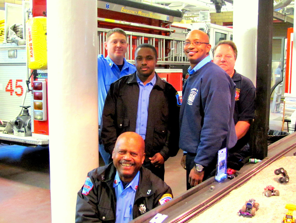 The firefighter modelers with Engine 45 behind them: Charles T. Smith (kneeling) and (left to right) Jason Turner, Tyrone Alford, Jon Evans and Harry Jackson. (Photo by Mark Reutter)