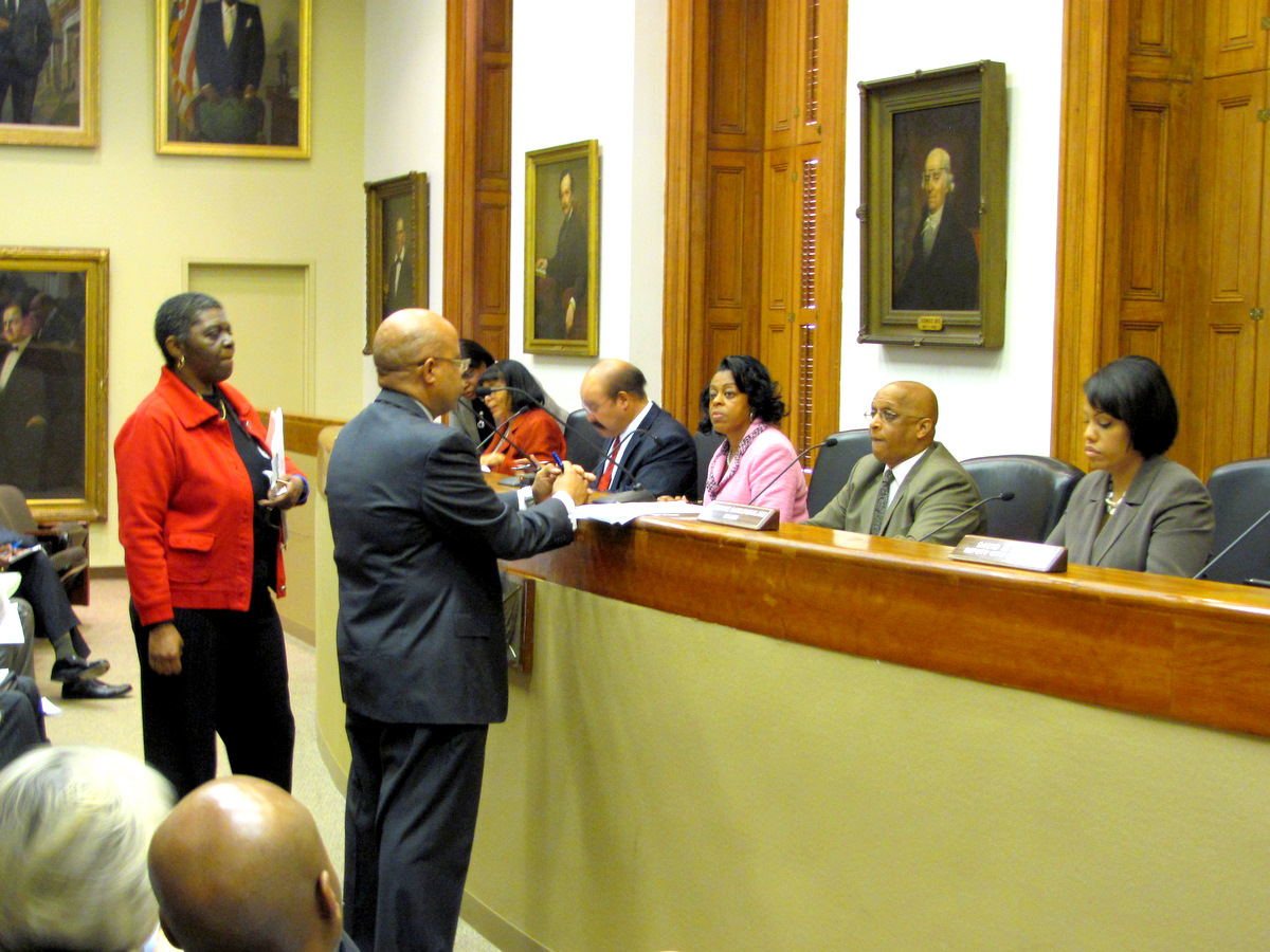 Trueheart addresses the Board of Estimates last year. On the far right is Mayor Stephanie Rawlings-Blake. Seated beside her is City Council President Jack Young and City Comptroller Joan Pratt, the other elected officials of the board. (Photo by Mark Reutter)