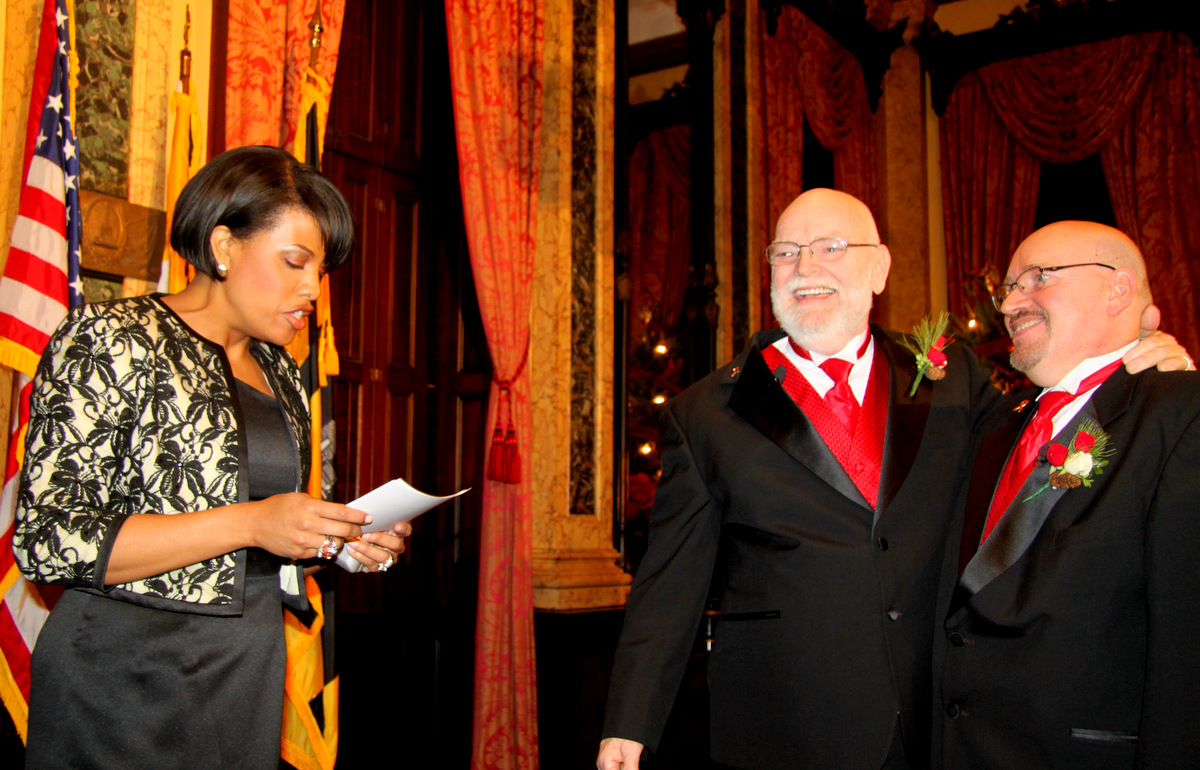 James Scales and William Tasker were wed early this morning by Mayor Rawlings-Blake, after Maryland's same-sex marriage law took effect. (Photo by Louie Krauss)