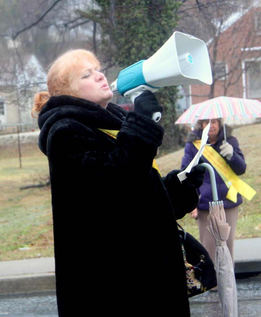 Rev. Karen Davis blessed the march. (Photo by Fern Shen)