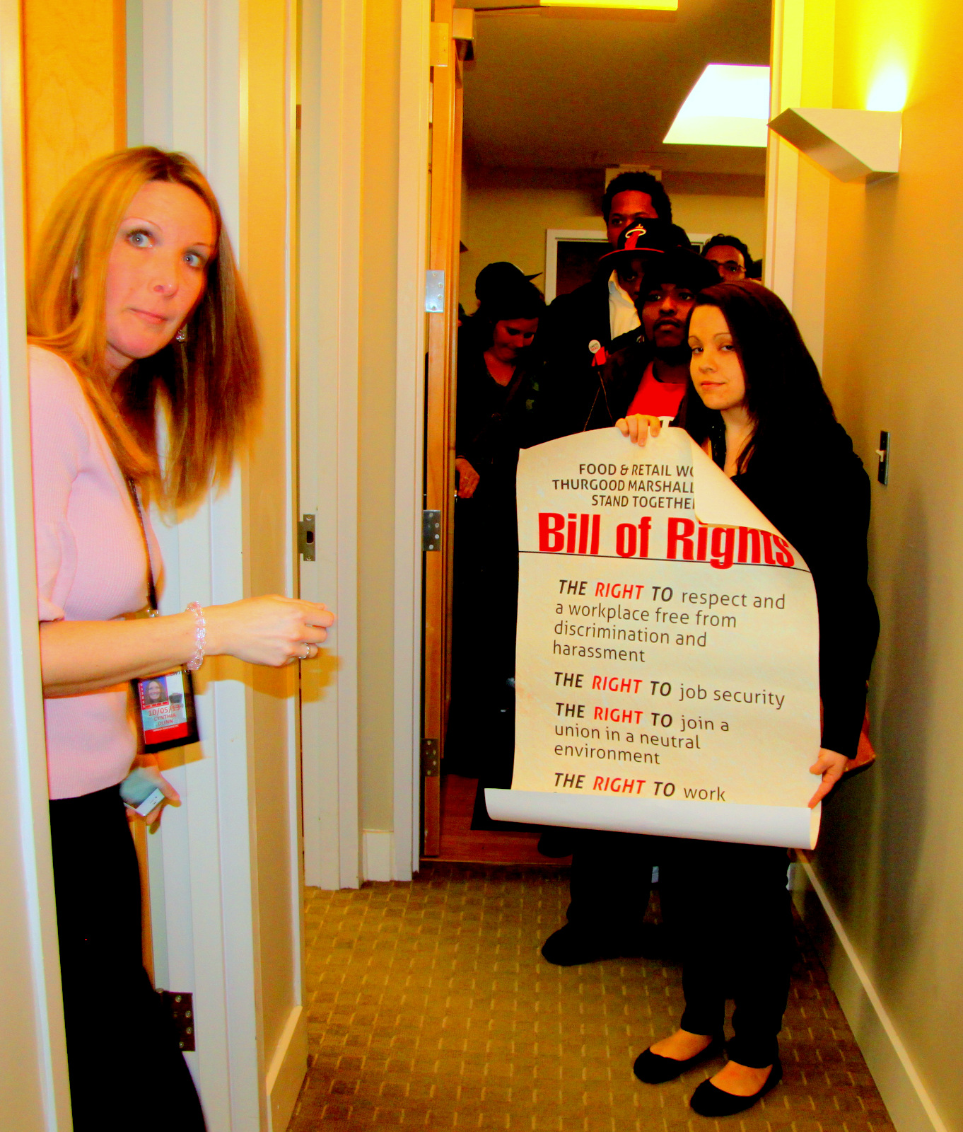 Workers organized by Unite Here presented a Bill of Rights to the company that manages airport concessions. (Photo by Fern Shen)