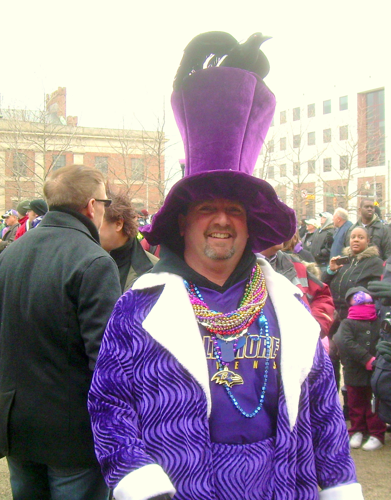 Walt Griffin, 50, from South Baltimore celebrates in purple plumage. (Photo by Gerald Neily)