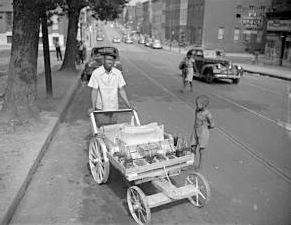 Man pushing snowball cart, Harlem Square Park, undated.
