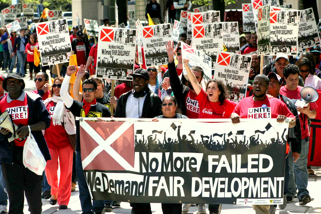 Yaseen is seen holding the banner during the march to the Inner Harbor after his speech. (Courtesy of Michael Fox, United Workers)