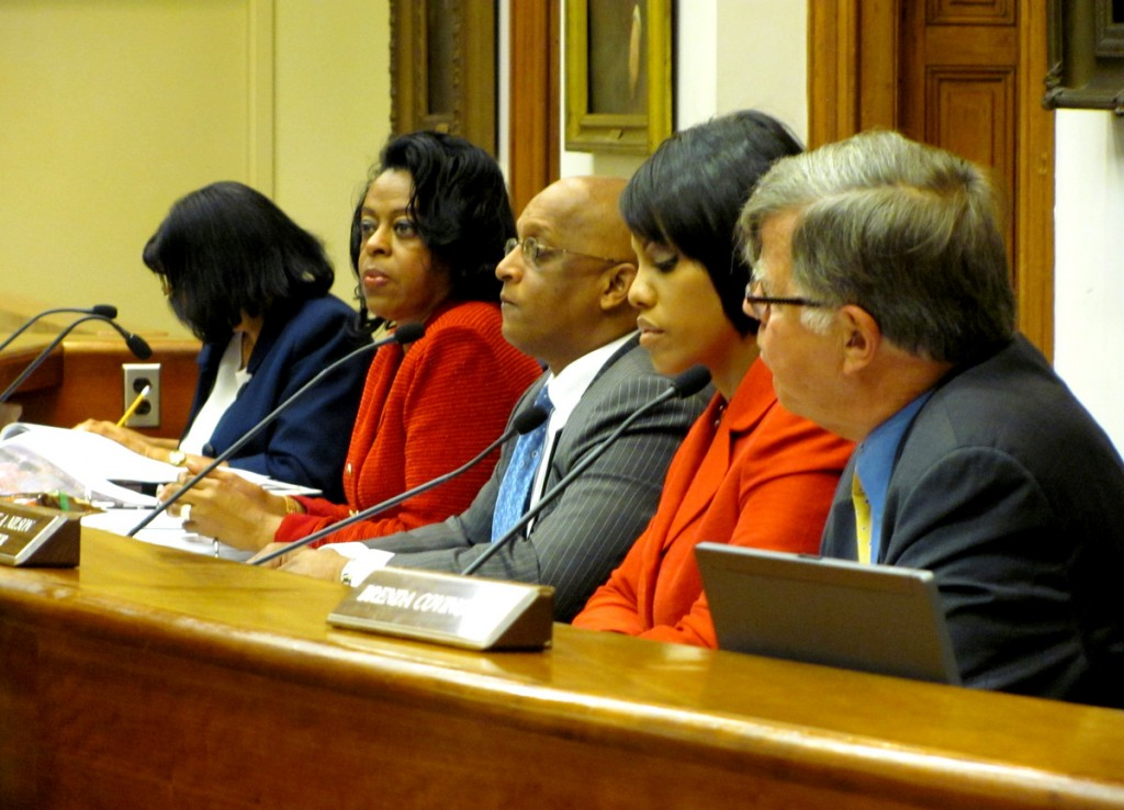 File photo of four members of the Board of Estimates. From right: City Solicitor George Nilson, Mayor Stephanie Rawlings-Blake, City Council President Jack Young and Comptroller Joan Pratt. Public Works Director Alfred Foxx is hidden between Pratt and board secretary Harriette Taylor. (Photo by Mark Reutter)