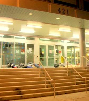 Homeless sprawled out on the foyer of the Health Care for the Homeless building. Some say they prefer sleeping outdoors than going to the city shelter. (Photo by Fern Shen)