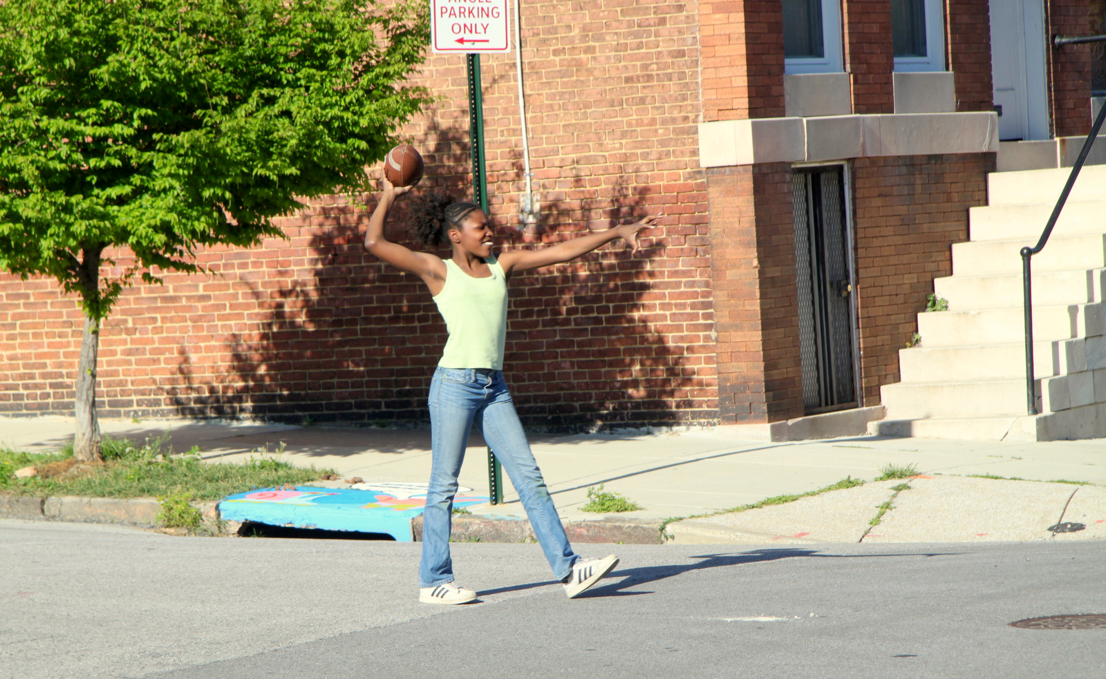 Tossing a ball at intersection of Boone and 21st  streets. (Photo by Fern Shen)