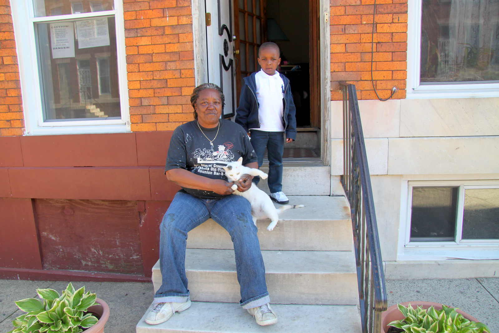 Jeanine Jones, with great grandson Kevin Jones, 5, lives across the street from a block of E. 21st St. that's half-vacant. (Photo by Fern Shen)