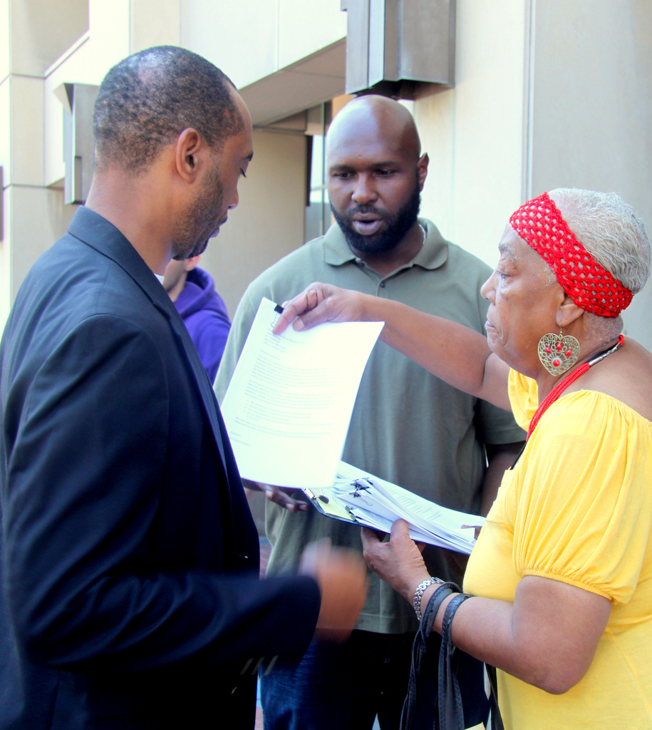 Mary Lawson brings Bel-Park residents' concerns to Housing's Anthony Scott. (Photo by Fern Shen)