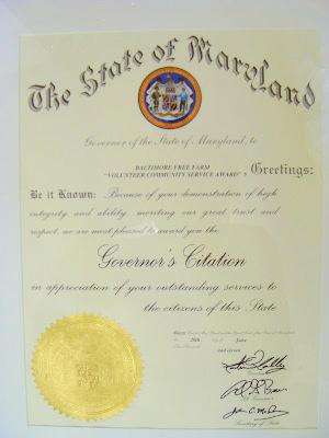 A Governor's Citation to Baltimore Free Farm for Volunteer Service.