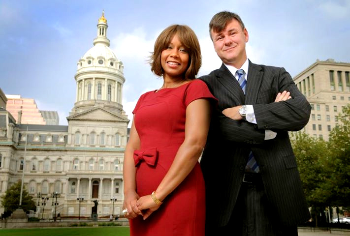 Lisa Harris Jones and Sean Malone pose in front of City Hall on their firm's website. (Harris Jones & Malone)