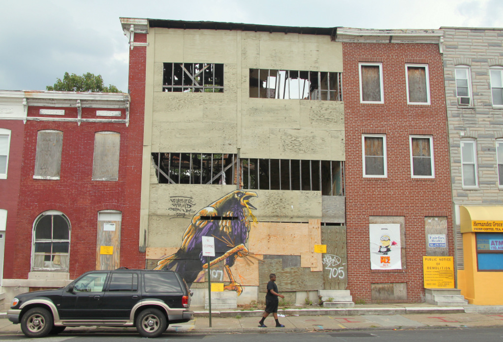 The city plans to knock down 703, 705, 707 and 709 Patterson Park Ave. in a few days. (Photo by Fern Shen)