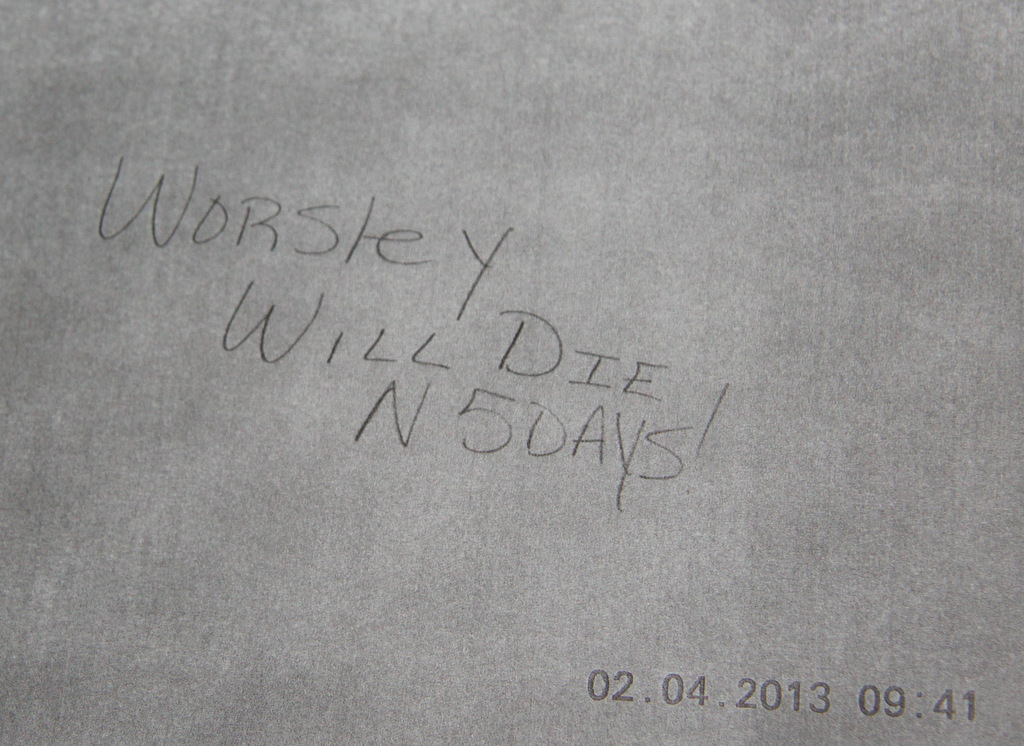A photo of graffiti threatening Bel-Park's housing manager. (Courtesy Mary Lawson)