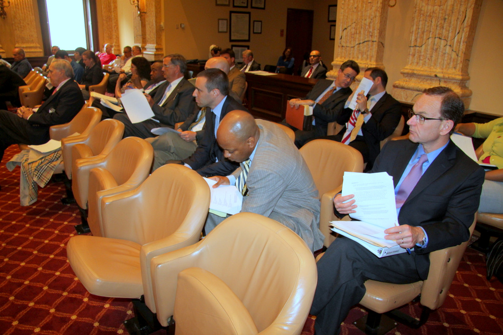 Under lobbyists' watchful eye, city council passes what remains of bill to cap Ticketmaster fees. (Photo by Fern Shen)
