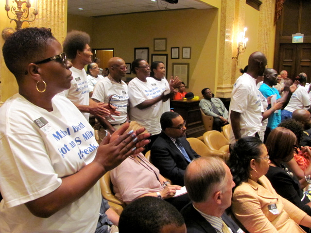 Perkins Homes residents question tax subsidies to Harbor Point at a City Hall hearing last month. (Photo by Mark Reutter)