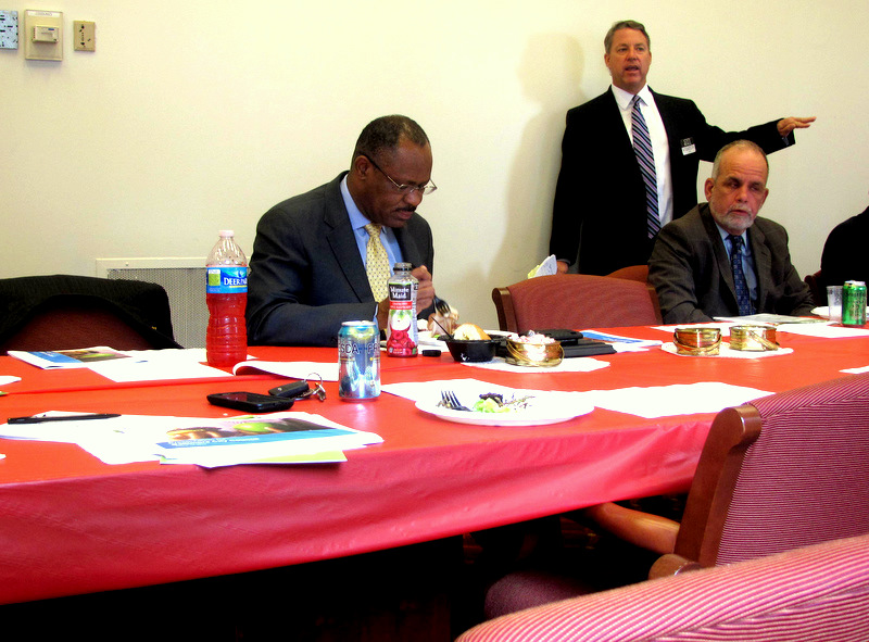 Carl Stokes eating at the Council's pre-meeting luncheon earlier today. (Photo by mark Reutter)