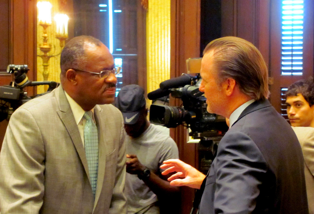 Councilman Stokes confers with Michael Beatty before the start of a hearing on the $107 million Harbor Point TIF last month. (Photo by Mark Reutter)