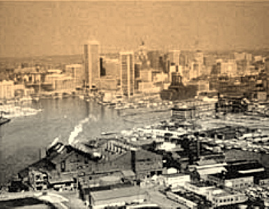 The Allied Chemical plant. operating in the 1980s at Harbor Point, with the newly reconstructed Inner Harbor in the background. (Photo from Maryland Department of the Environment)