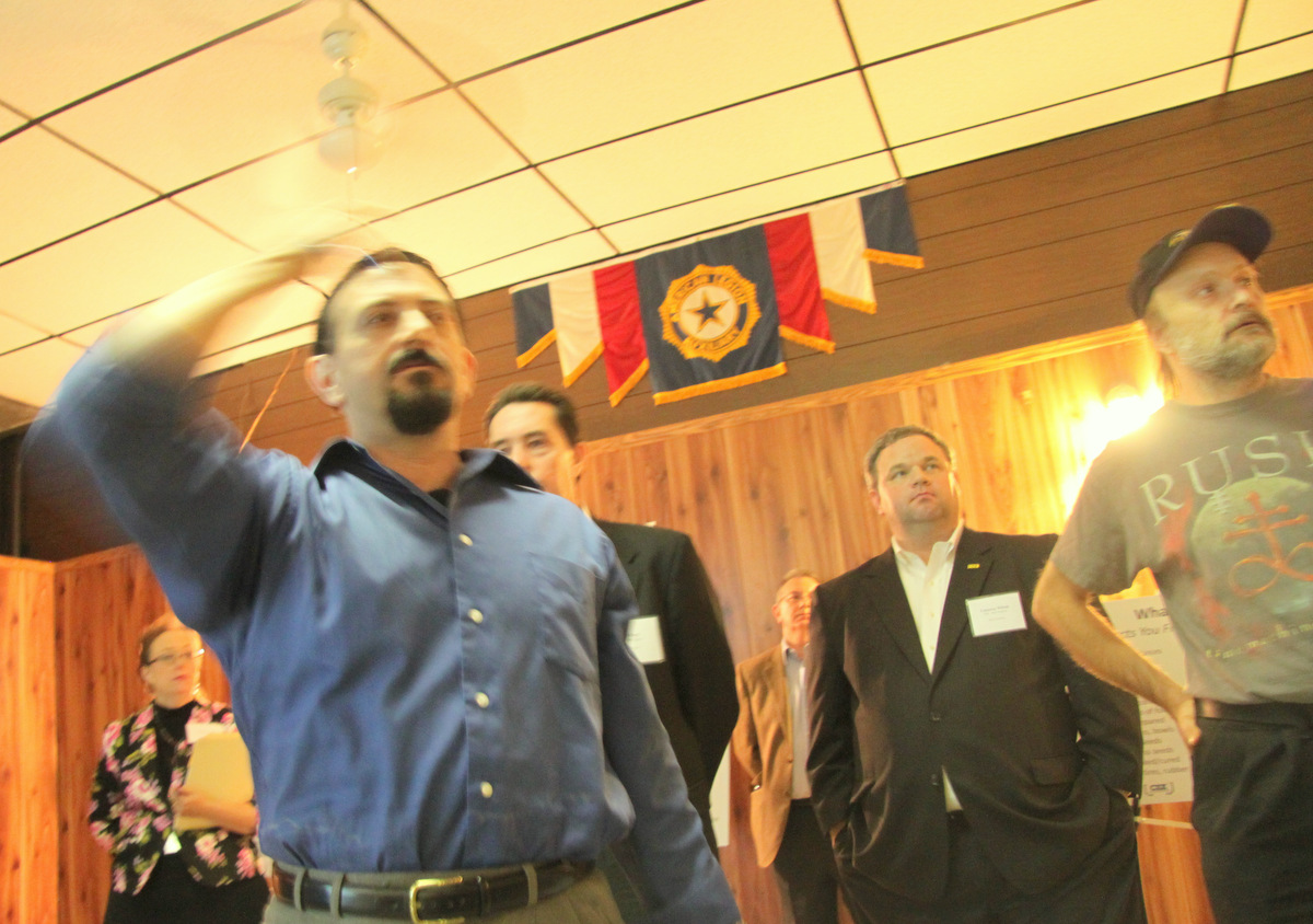 Morrell Park's Paul DeNoble speaks, as CSX officials stand behind him. (Photo by fern Shen)