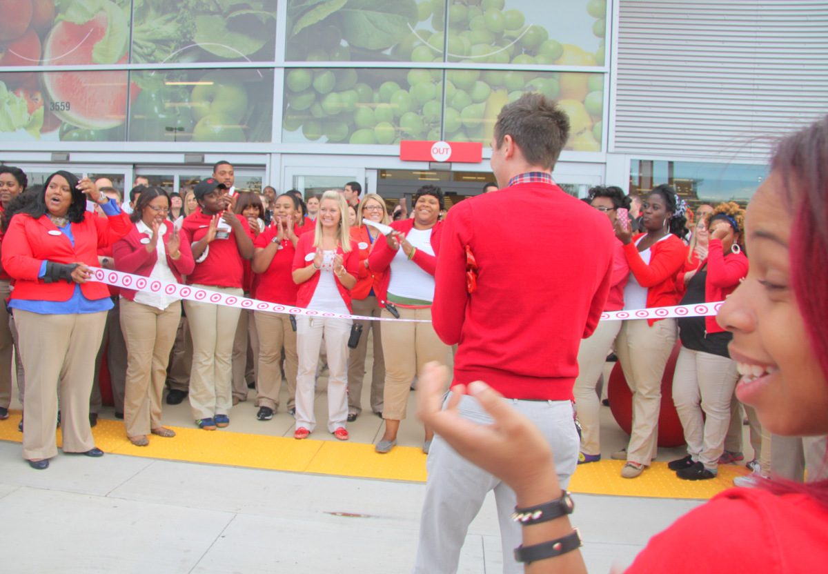 Target employees got a pep talk before the store opened for business. (Photo by Fern Shen)