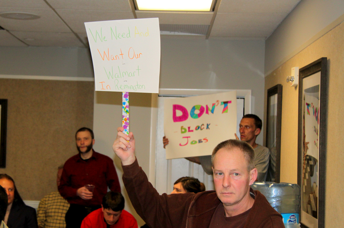 Some of the audience members calling for the Commission to advance the Wal-Mart project. (Photo by Fern Shen)