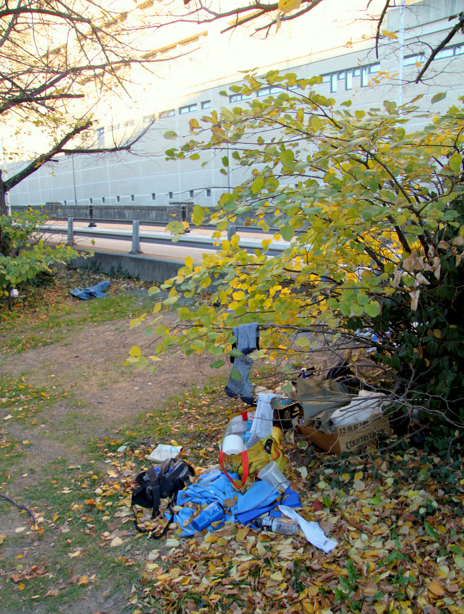 Socks, water bottles, toilet paper and other items at former Camp 83 site. (Photo by Fern Shen)