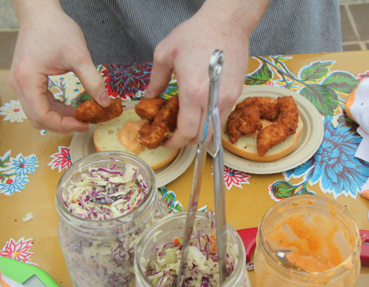 Shoo-Fly Diner fried up the student-raised fish, adding some sauce and slaw. (Photo by Fern Shen)