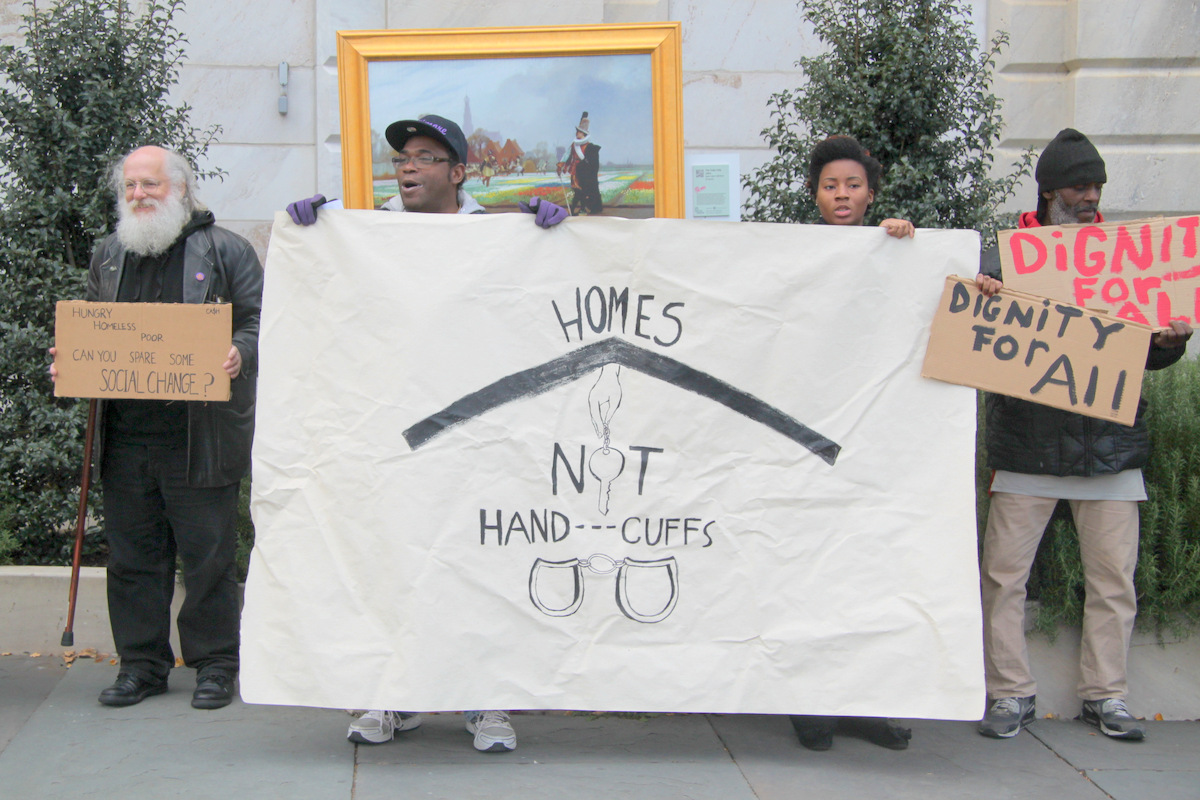 Part of a group of about 15 people who came to protest Baltimore's proposed panhandling ban. (Photo by Fern Shen)