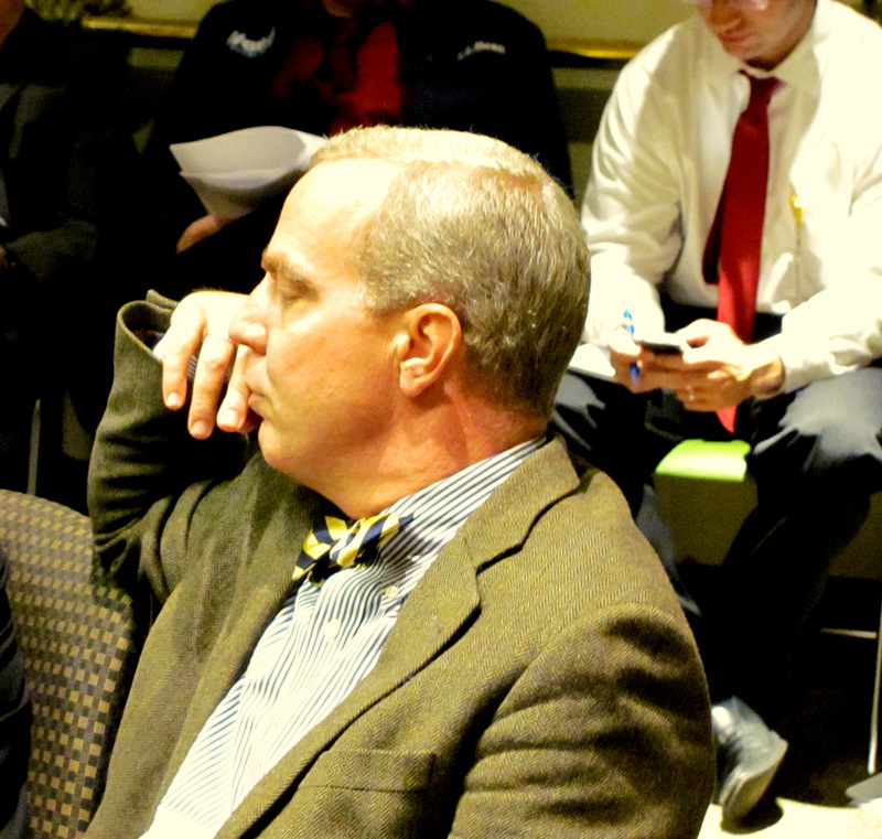 Peter Auchincloss, a member of the Dynis team and chairman of the city's Parking Authority, listens at today's meeting. (Photo by Mark Reutter)