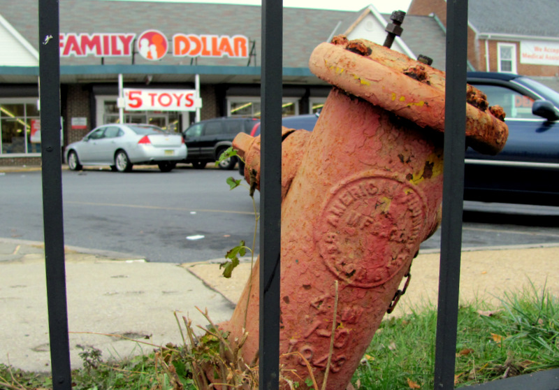 Ill-kept: an old fire hydrant leans to its side in front of one of the two