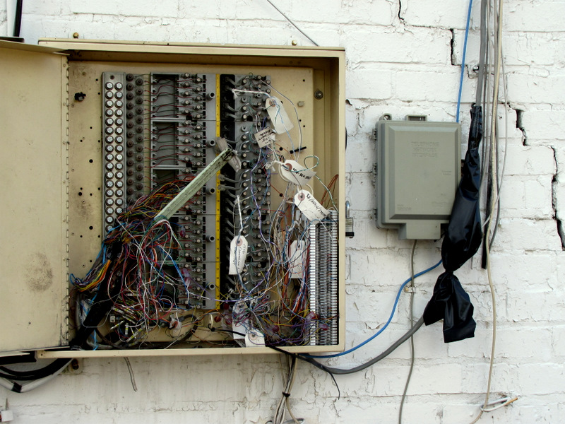 An electrical box exposed to the elements at rear of the Edmondson Shopping Center on November 8. (Photo by Mark Reutter)