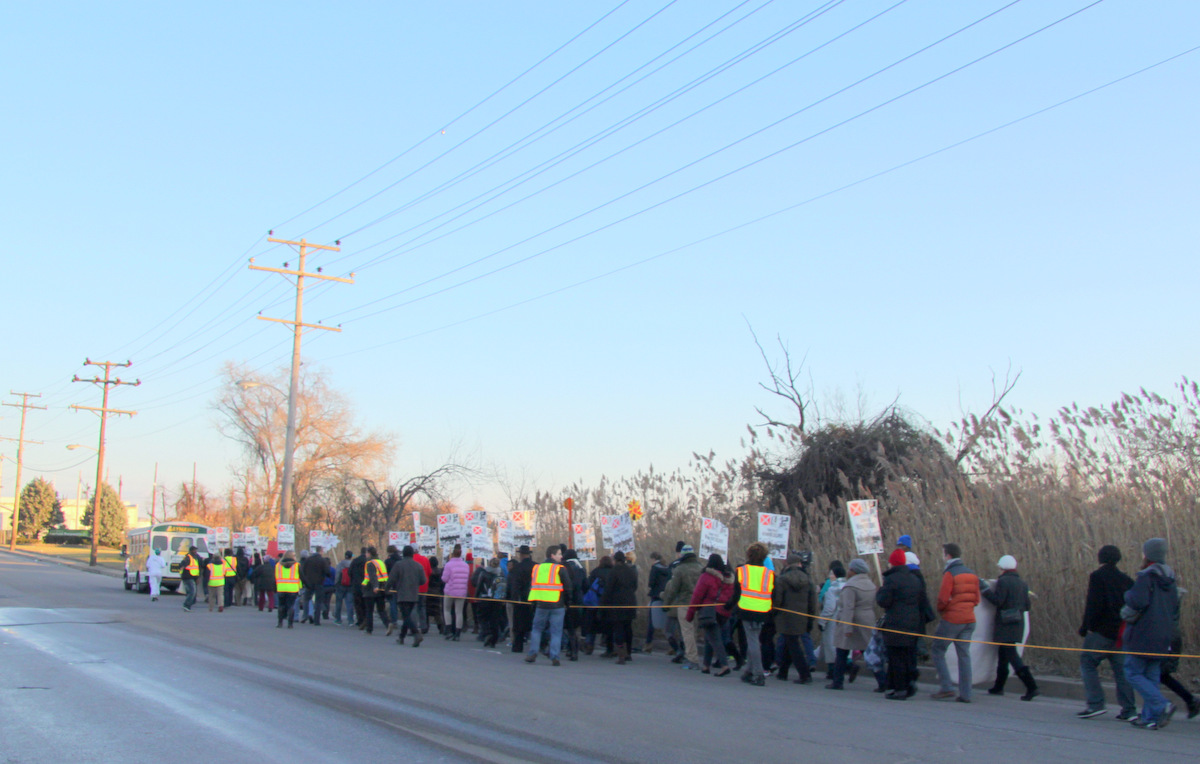 The march went down E. Patapsco Avenue to the incinerator site. (Photo by Fern Shen)
