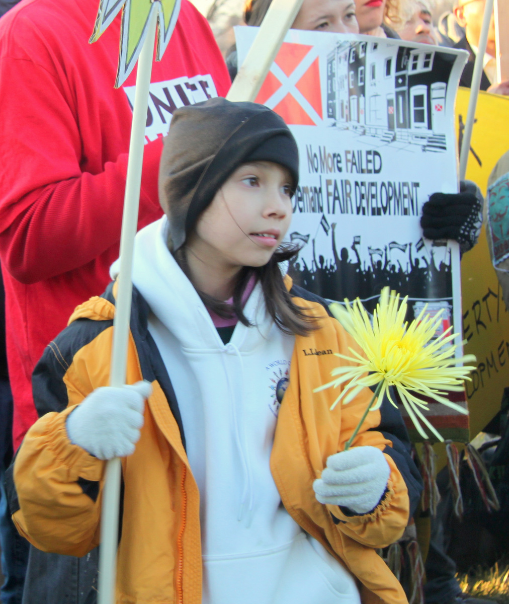 Thanya Fox, 11, was among the marchers. (Photo by Fern Shen)