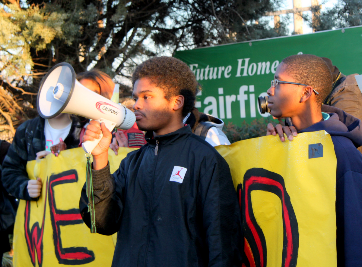 Charles Graham addresses the marchers. (Photo by Fern Shen)