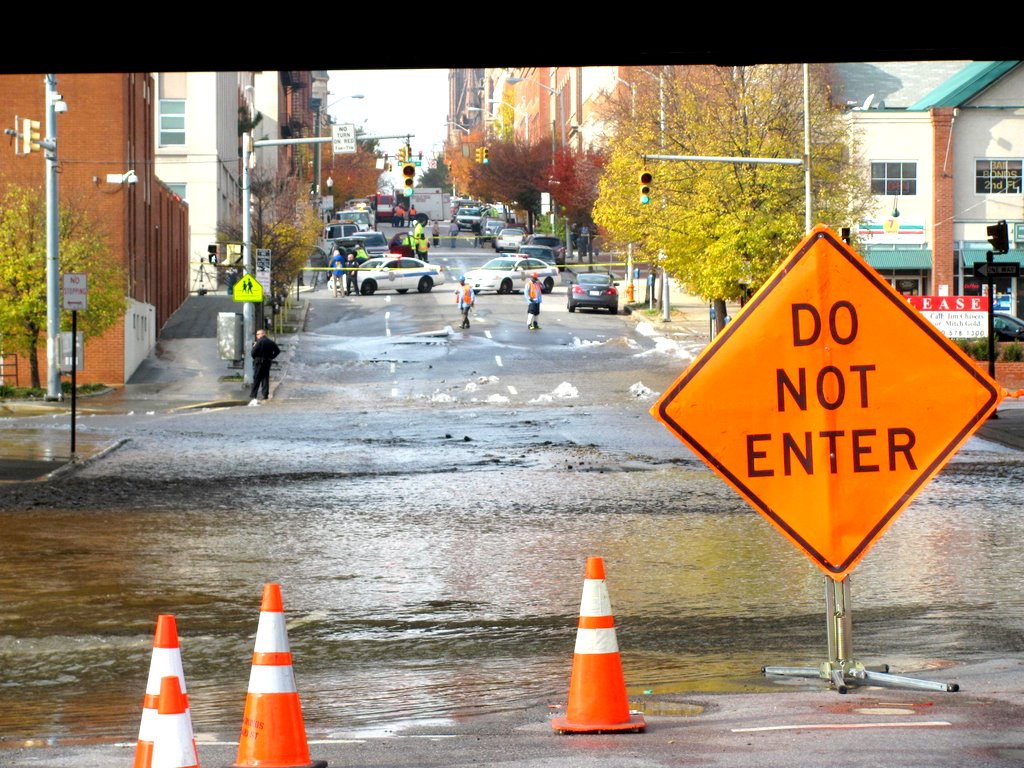 Scene from a break of the same water main last November 2012, which sent water gushing into the parking lot at Guilford and Madison. (Photo by Mark Reutter)