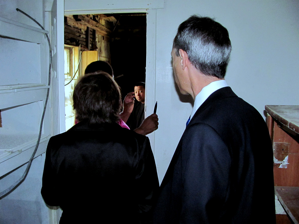 Last year, housing officials Stacy Freed (left) Peter Engel toured a building on Annapolis Road that some Westport residents wanted turned into a community center. The city never followed up on the plan and the dilapidated building is now owned by the city. (Photo by Mark Reutter)
