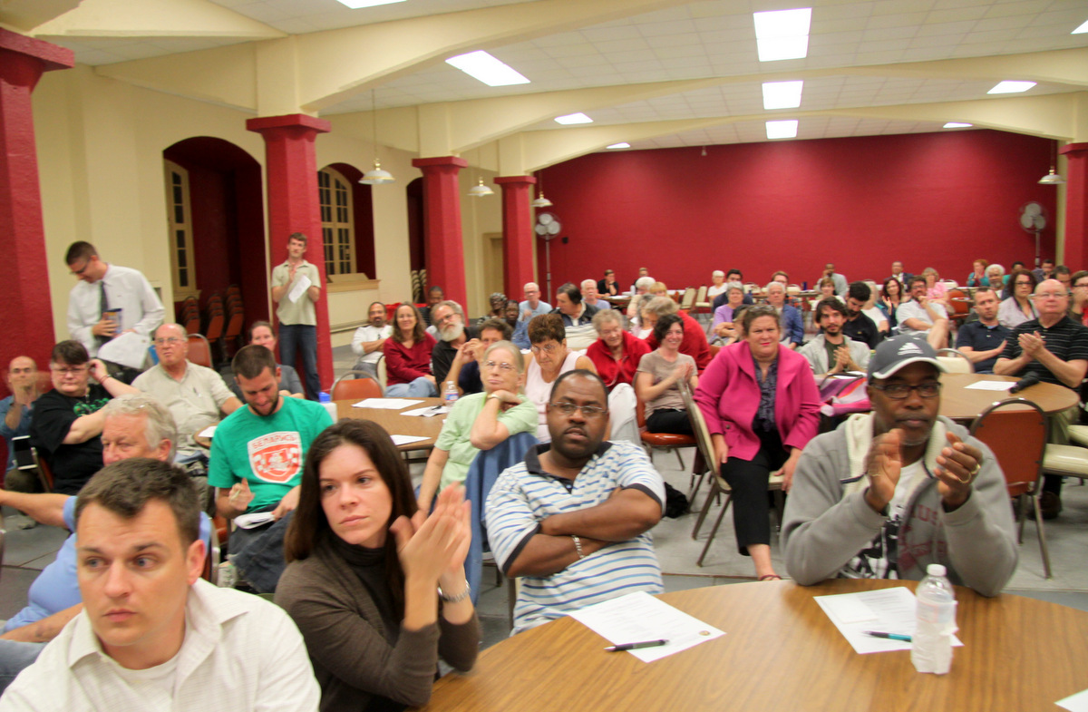 A packed meeting on the Wal-Mart project  where citizens sought to slow the process and improve the design. (Photo by Fern Shen)