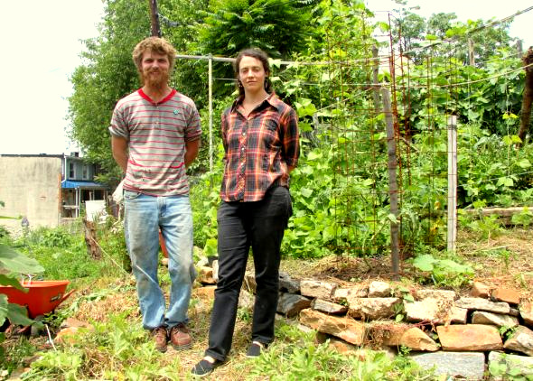 Billy Thomas and Reagan Hooton at Baltimore Free Farm's threatened land in Hampden-Woodberry. (Photo by Fern Shen)