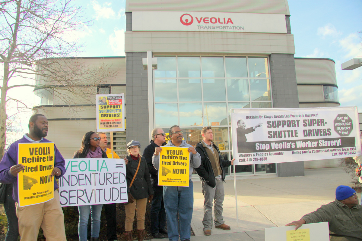 SuperShuttle drivers and their supporters protesting outside the Baltimore offices of Veolia Transportation, SuperShuttle's corporate parent. (Photo by Fern Shen)