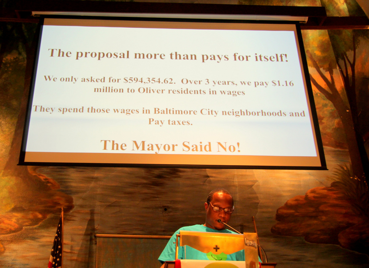The crowd booed, as speakers accused the Mayor of forsaking the jobs program. (Photo by Fern Shen)