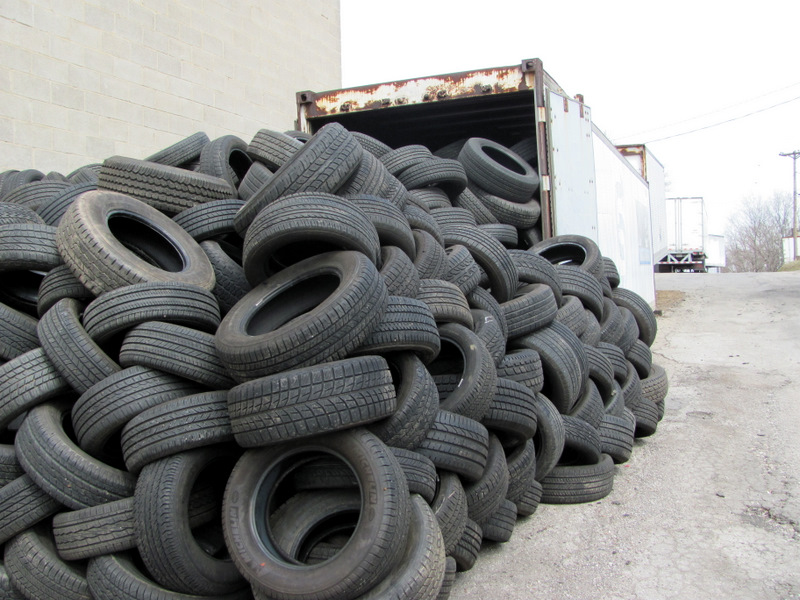 Tires piled up Tuesday on Moreland Avenue by the Emanuel Tire Co. and (below) stored next to historic St Peter's Cemetery. (Photos by Mark Reutter)