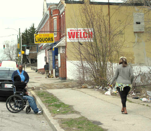 Councilman Welch said upon his 2011 appointment to the body that one of his top priorities was to rejuvenate Poplar Grove Street. Here is the debris-strewn 800 block, featuring the No Rush Liquor Store, on Tuesday. (Photo by Mark Reutter)
