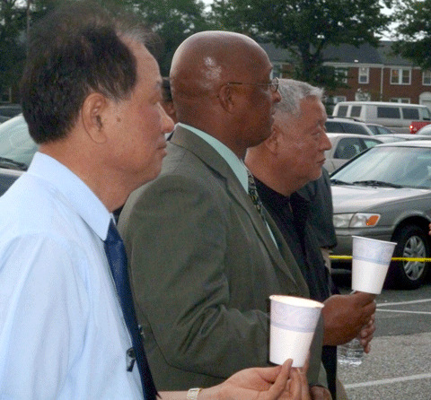 Young participates in a candlelight vigil for a Korean-American businessman slain outside an East Baltimore liquor store in 2011. (File photo)