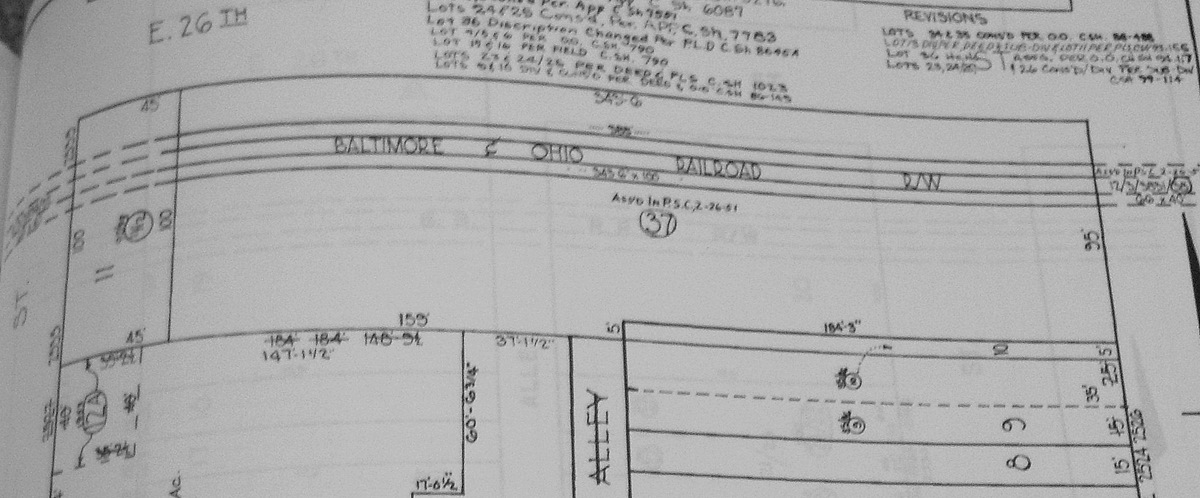 This survey map shows the 344-by-100 foot hole dug by the B&O Railroad to site the planned station south of 26th Street. (Baltimore Land Records Office)