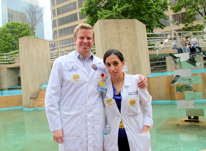 Hopkins physicians Benjamin Oldfield and Jocelyn Ronda spoke up in support of the workers. (Photo by Fern Shen)